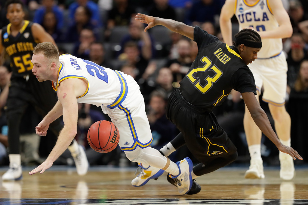 . SACRAMENTO, CA - MARCH 17:  Bryce Alford #20 of the UCLA Bruins battles for the ball with Jaylin Walker #23 of the Kent State Golden Flashes during the first round of the 2017 NCAA Men\'s Basketball Tournament at Golden 1 Center on March 17, 2017 in Sacramento, California.  (Photo by Jamie Squire/Getty Images)