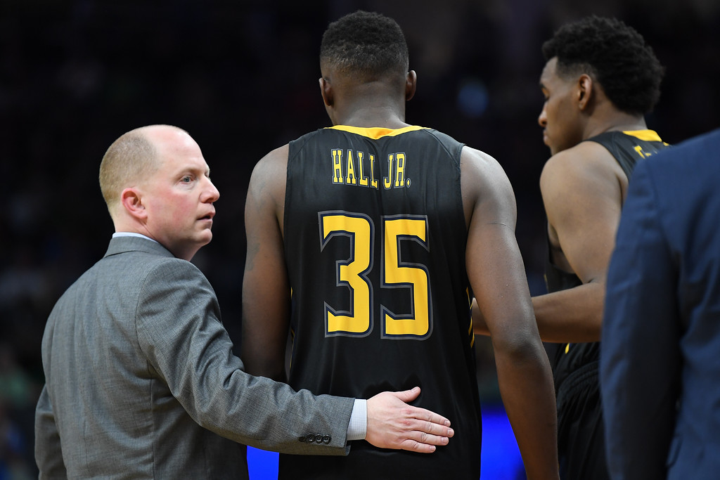 . SACRAMENTO, CA - MARCH 17:  Jimmy Hall #35 is consoled by his Head coach Rob Senderoff of the Kent State Golden Flashes as his team loses to the UCLA Bruins during the first round of the 2017 NCAA Men\'s Basketball Tournament at Golden 1 Center on March 17, 2017 in Sacramento, California.  (Photo by Thearon W. Henderson/Getty Images)