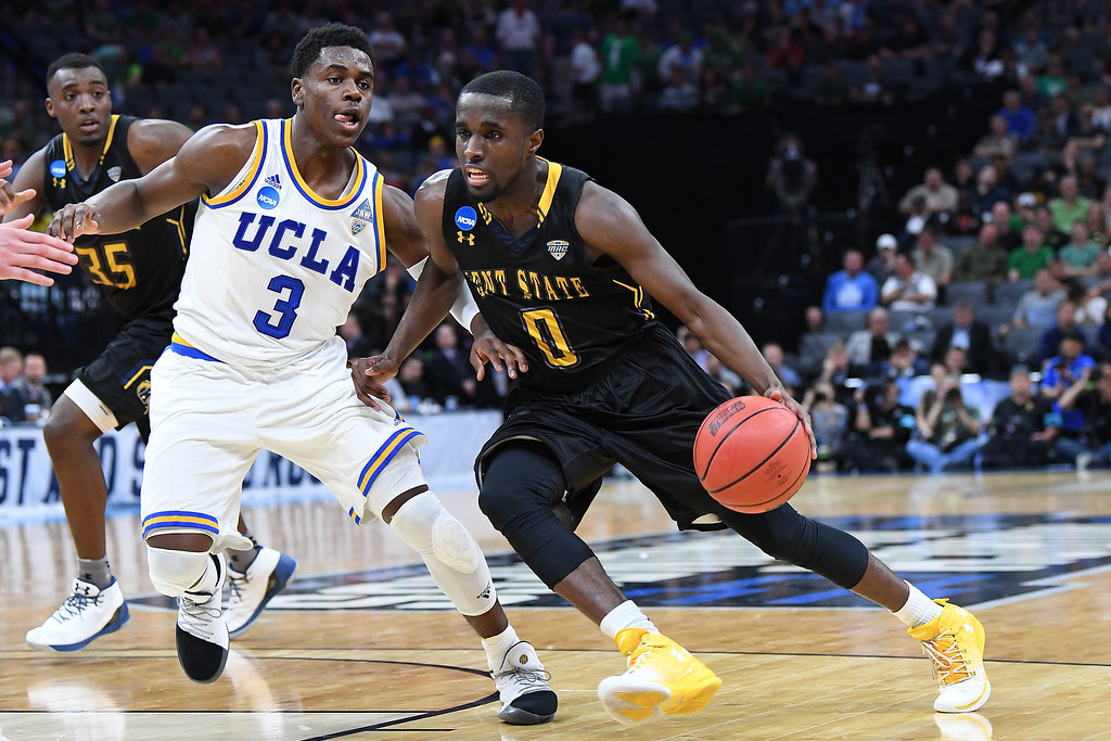 . SACRAMENTO, CA - MARCH 17: Jalen Avery #0 of the Kent State Golden Flashes is defended by Aaron Holiday #3 of the UCLA Bruins during the first round of the 2017 NCAA Men\'s Basketball Tournament at Golden 1 Center on March 17, 2017 in Sacramento, California.  (Photo by Thearon W. Henderson/Getty Images)