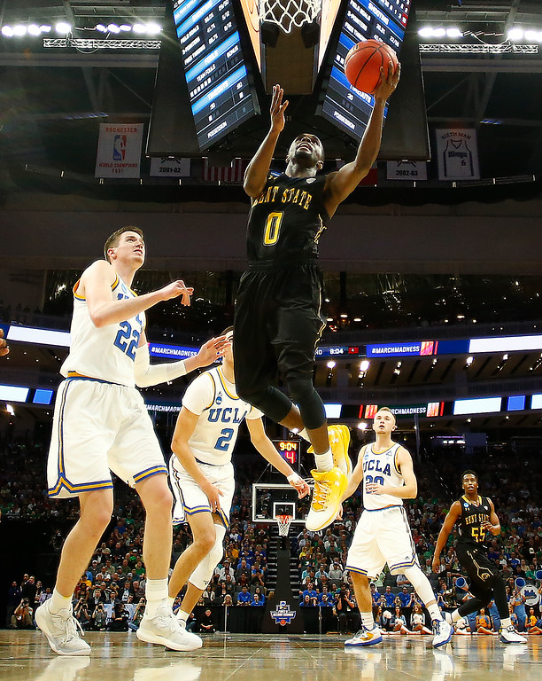 . SACRAMENTO, CA - MARCH 17:  Jalen Avery #0 of the Kent State Golden Flashes attempts a shot against the UCLA Bruins during the first round of the 2017 NCAA Men\'s Basketball Tournament at Golden 1 Center on March 17, 2017 in Sacramento, California.  (Photo by Jamie Squire/Getty Images)