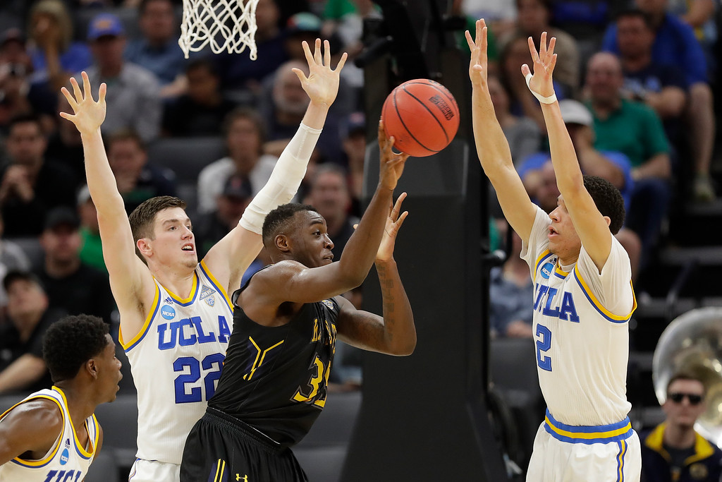 . SACRAMENTO, CA - MARCH 17: Jimmy Hall #35 of the Kent State Golden Flashes looks to pass defended by TJ Leaf #22 and Lonzo Ball #2 of the UCLA Bruins during the first round of the 2017 NCAA Men\'s Basketball Tournament at Golden 1 Center on March 17, 2017 in Sacramento, California.  (Photo by Jamie Squire/Getty Images)