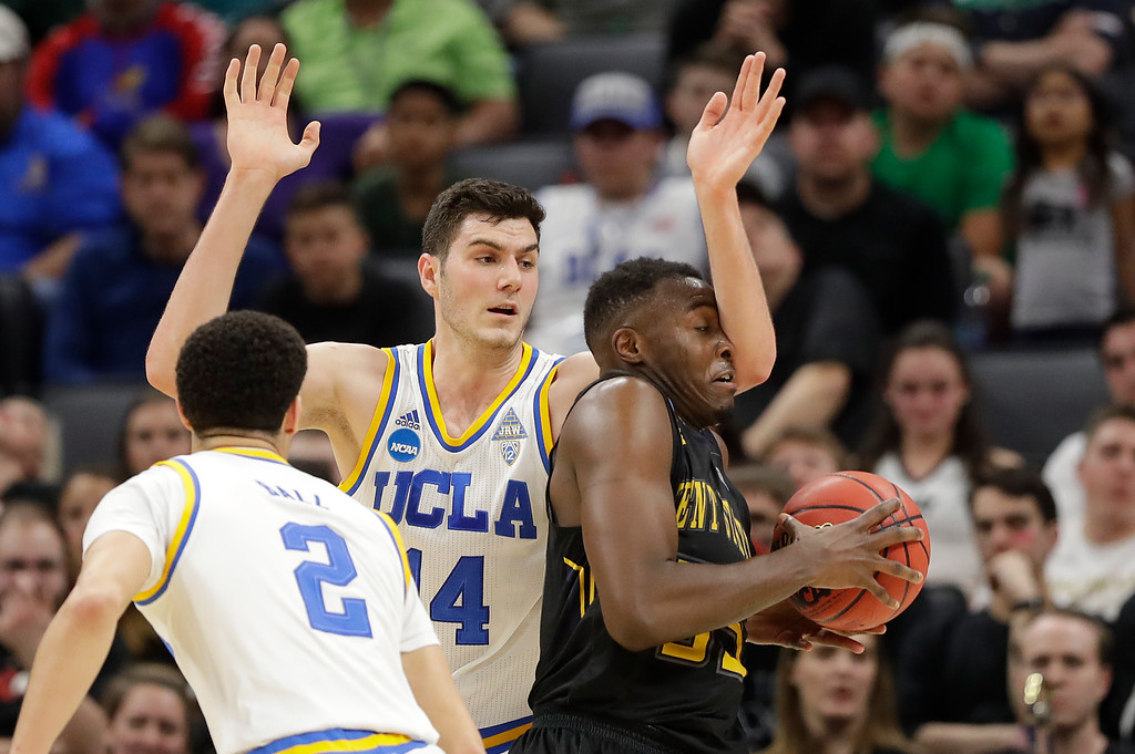 . SACRAMENTO, CA - MARCH 17: Jimmy Hall #35 of the Kent State Golden Flashes is defended by Gyorgy Goloman #14 of the UCLA Bruins during the first round of the 2017 NCAA Men\'s Basketball Tournament at Golden 1 Center on March 17, 2017 in Sacramento, California.  (Photo by Jamie Squire/Getty Images)