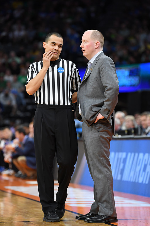 . SACRAMENTO, CA - MARCH 17:Head coach Rob Senderoff of the Kent State Golden Flashes speaks with the official against the UCLA Bruins during the first round of the 2017 NCAA Men\'s Basketball Tournament at Golden 1 Center on March 17, 2017 in Sacramento, California.  (Photo by Thearon W. Henderson/Getty Images)