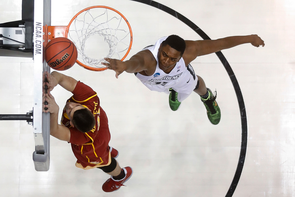 . Southern California\'s Nick Rakocevic, left, shoots against Providence\'s Kalif Young during the first half of a First Four game of the NCAA men\'s college basketball tournament, Wednesday, March 15, 2017, in Dayton, Ohio. (AP Photo/John Minchillo)