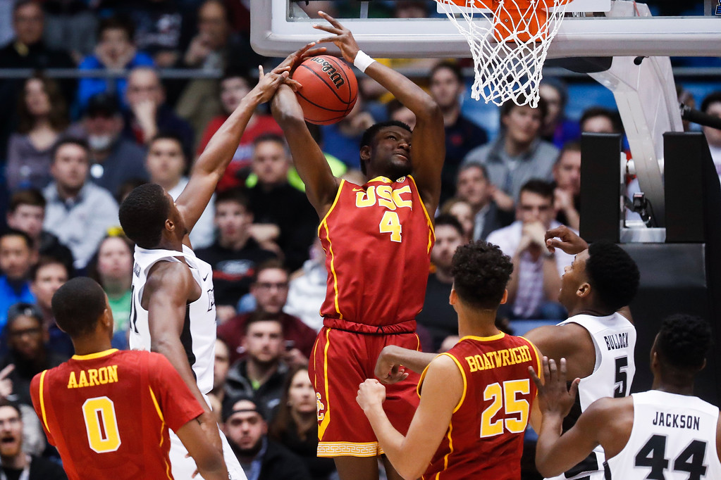 . Providence\'s Alpha Diallo, center left, blocks a shot by Southern California\'s Chimezie Metu (4) during the first half of a First Four game of the NCAA men\'s college basketball tournament, Wednesday, March 15, 2017, in Dayton, Ohio. (AP Photo/John Minchillo)