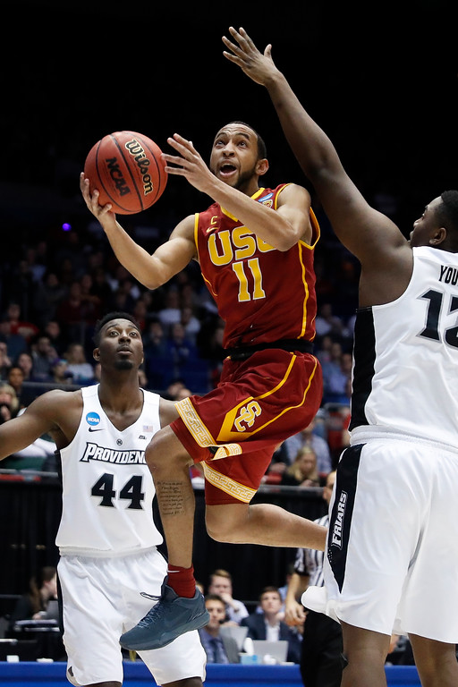 . CORRECTS TO SECOND HALF - Southern California\'s Jordan McLaughlin (11) shoots against Providence\'s Casey Woodring (12) as Isaiah Jackson (44) watches during the second half of a First Four game of the NCAA men\'s college basketball tournament, Wednesday, March 15, 2017, in Dayton, Ohio. Southern California won 75-71. (AP Photo/John Minchillo)