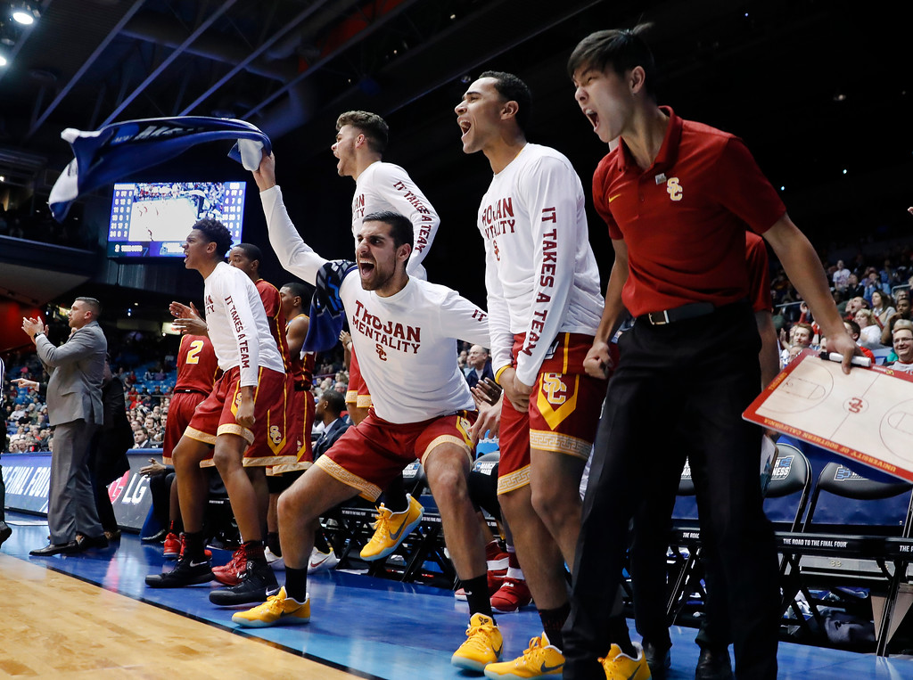 . The Southern California bench reacts during the second half of the team\'s First Four game against Providence in the NCAA men\'s college basketball tournament, Wednesday, March 15, 2017, in Dayton, Ohio. Southern California won 75-71. (AP Photo/John Minchillo)