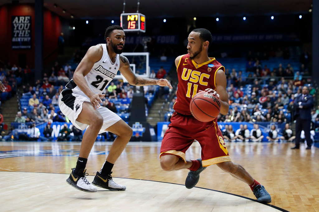 . Southern California\'s Jordan McLaughlin (11) drives against Providence\'s Jalen Lindsey (21) during the second half of a First Four game of the NCAA men\'s college basketball tournament, Wednesday, March 15, 2017, in Dayton, Ohio. Southern California won 75-71. (AP Photo/John Minchillo)