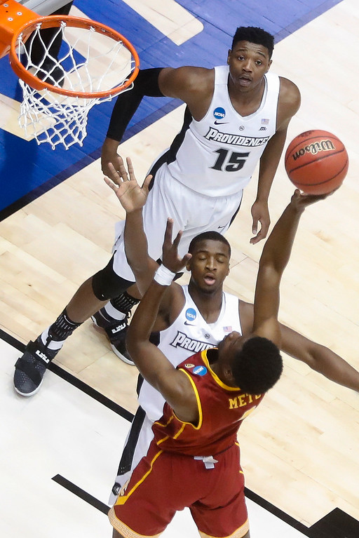. Southern California\'s Chimezie Metu (4) shoots against Providence\'s Alpha Diallo, center, as Emmitt Holt (15) watches during the first half of a First Four game of the NCAA men\'s college basketball tournament, Wednesday, March 15, 2017, in Dayton, Ohio. (AP Photo/John Minchillo)
