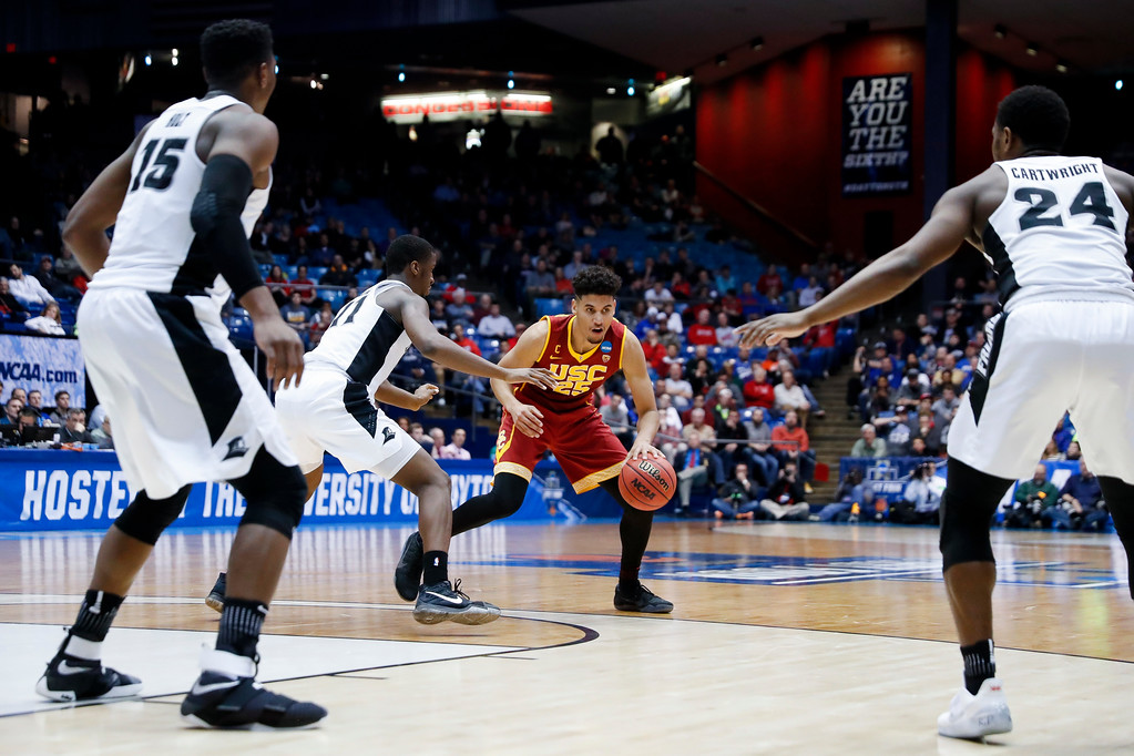 . Southern California\'s Bennie Boatwright (25) looks to pass against Providence\'s Alpha Diallo (11) as Emmitt Holt (15) and Kyron Cartwright (24) watch during the second half of a First Four game of the NCAA men\'s college basketball tournament, Wednesday, March 15, 2017, in Dayton, Ohio. Southern California won 75-71. (AP Photo/John Minchillo)