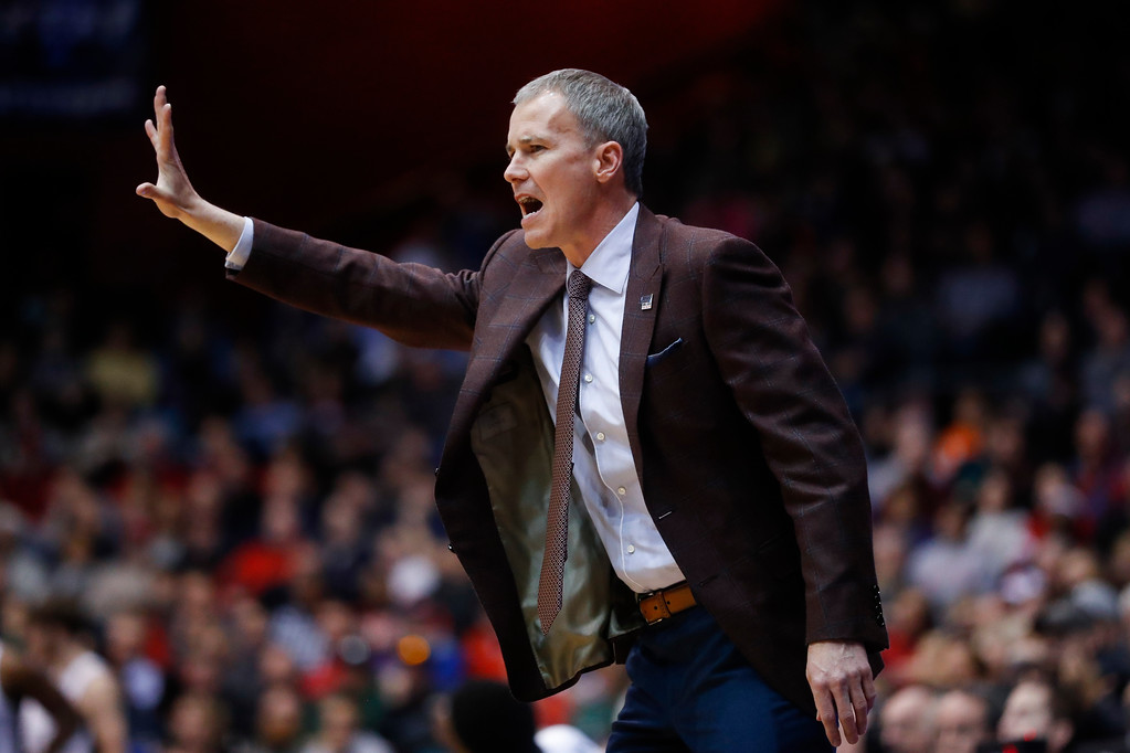. Southern California coach Andy Enfield gestures to his players during the first half of a First Four game of the NCAA men\'s college basketball tournament, against Providence on Wednesday, March 15, 2017, in Dayton, Ohio. (AP Photo/John Minchillo)