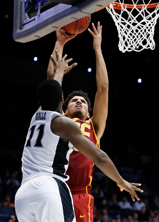 . Southern California\'s Bennie Boatwright (25) shoots against Providence\'s Alpha Diallo (11) during the second half of a First Four game of the NCAA men\'s college basketball tournament, Wednesday, March 15, 2017, in Dayton, Ohio. Southern California won 75-71. (AP Photo/John Minchillo)
