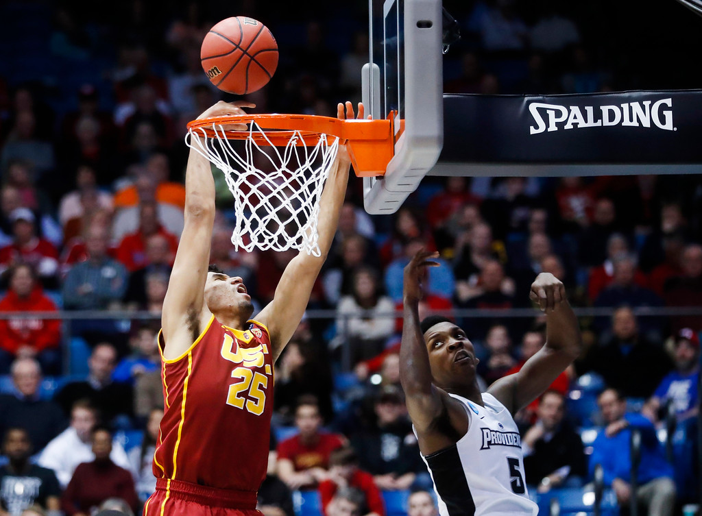 . CORRECTS TO SECOND HALF - Southern California\'s Bennie Boatwright (25) shoots against Providence\'s Rodney Bullock (5) during the second half of a First Four game of the NCAA men\'s college basketball tournament, Wednesday, March 15, 2017, in Dayton, Ohio.(AP Photo/John Minchillo)