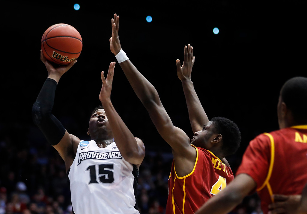 . Providence\'s Emmitt Holt (15) shoots against Southern California\'s Chimezie Metu (4) during the first half of a First Four game of the NCAA men\'s college basketball tournament, Wednesday, March 15, 2017, in Dayton, Ohio. (AP Photo/John Minchillo)