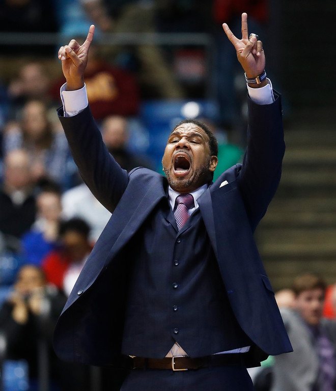 . Providence coach Ed Cooley signals to his players during the second half of a First Four game against Southern California in the NCAA men\'s college basketball tournament, Wednesday, March 15, 2017, in Dayton, Ohio. Southern California won 75-71. (AP Photo/John Minchillo)