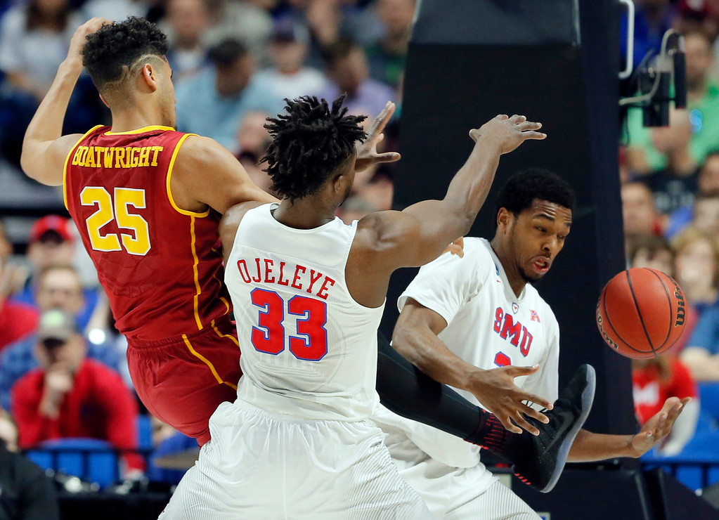 . SMU\'s Semi Ojeleye (33) and Sterling Brown, right, combine to grab a rebound in front of USC\'s Bennie Boatwright (25) in the first half of a first-round game in the men\'s NCAA college basketball tournament in Tulsa, Okla., Friday March 17, 2017. (AP Photo/Tony Gutierrez)