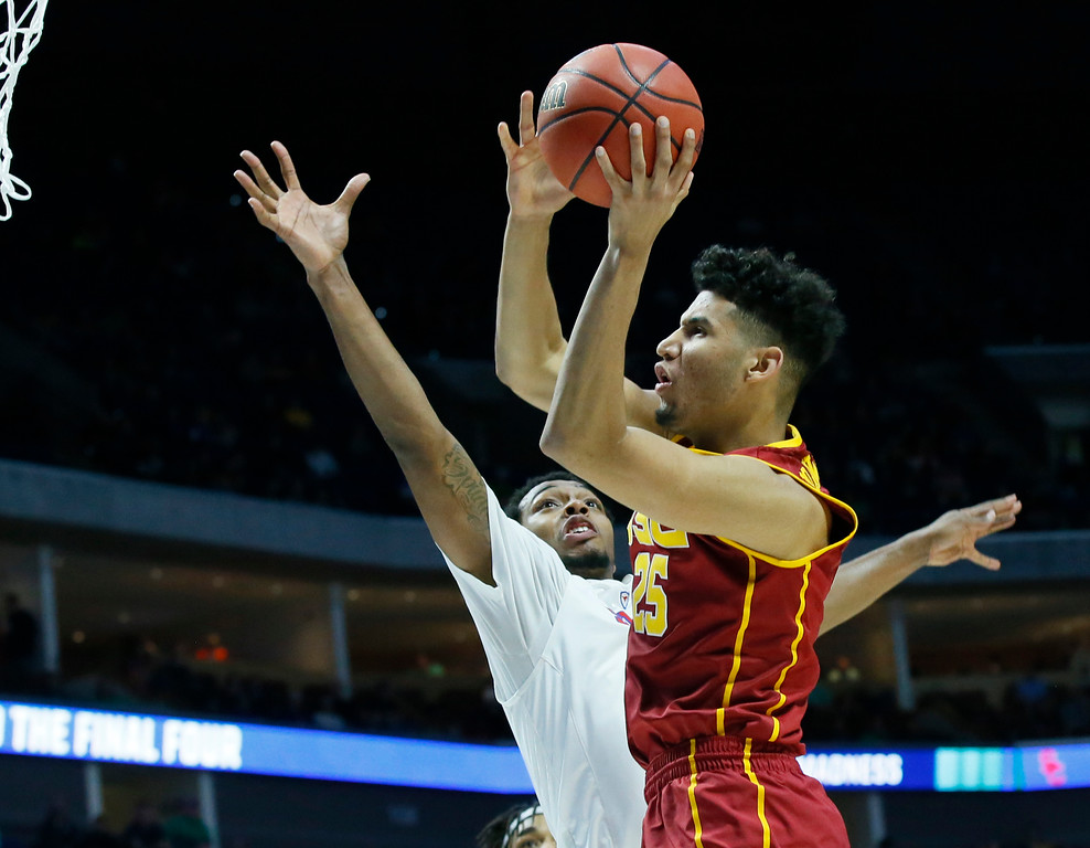 . Southern California forward Bennie Boatwright (25) shoots in front of Southern Methodist guard Sterling Brown, left, in the first half of a first-round game in the men\'s NCAA college basketball tournament in Tulsa, Okla., Friday, March 17, 2017. (AP Photo/Sue Ogrocki)