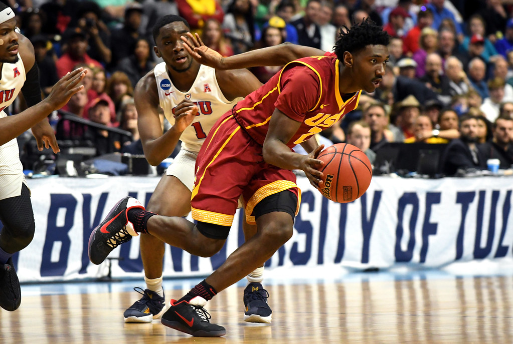 . TULSA, OK - MARCH 17: Jonah Mathews #2 of the USC Trojans handles the ball in the first half against Shake Milton #1 of the Southern Methodist Mustangs during the first round of the 2017 NCAA Men\'s Basketball Tournament at BOK Center on March 17, 2017 in Tulsa, Oklahoma.  (Photo by J Pat Carter/Getty Images)