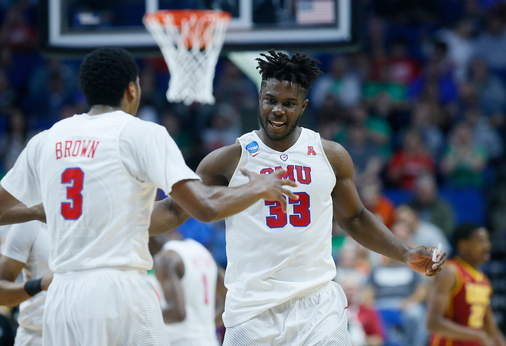 . Southern Methodist forward Semi Ojeleye (33) celebrates a basket with teammate Sterling Brown (3) in the first half of a first-round game against Southern California in the men\'s NCAA college basketball tournament in Tulsa, Okla., Friday, March 17, 2017. (AP Photo/Sue Ogrocki)