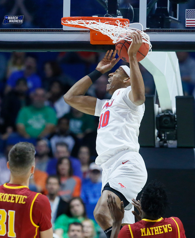 . Southern Methodist guard Jarrey Foster (10) dunks in front of Southern California forward Nick Rakocevic (31) and Jonah Mathews (2) in the first half of a first-round game in the men\'s NCAA college basketball tournament in Tulsa, Okla., Friday, March 17, 2017. (AP Photo/Sue Ogrocki)