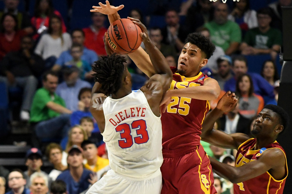 . TULSA, OK - MARCH 17: Semi Ojeleye #33 of the Southern Methodist Mustangs attempts to shoot against Bennie Boatwright #25 of the USC Trojans in the first half during the first round of the 2017 NCAA Men\'s Basketball Tournament at BOK Center on March 17, 2017 in Tulsa, Oklahoma.  (Photo by J Pat Carter/Getty Images)