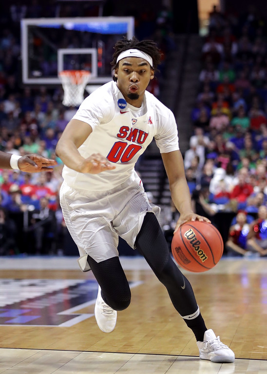 . TULSA, OK - MARCH 17: Ben Moore #0 of the Southern Methodist Mustangs handles the ball against USC Trojans in the first half during the first round of the 2017 NCAA Men\'s Basketball Tournament at BOK Center on March 17, 2017 in Tulsa, Oklahoma.  (Photo by Ronald Martinez/Getty Images)