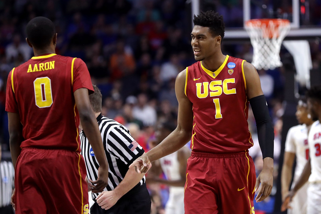 . TULSA, OK - MARCH 17: Charles Buggs #1 of the USC Trojans reacts with Shaqquan Aaron #0 in the first half against the Southern Methodist Mustangs during the first round of the 2017 NCAA Men\'s Basketball Tournament at BOK Center on March 17, 2017 in Tulsa, Oklahoma.  (Photo by Ronald Martinez/Getty Images)