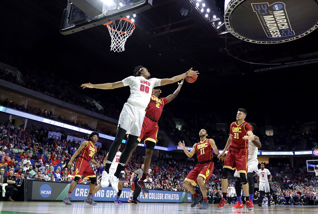 . TULSA, OK - MARCH 17: Ben Moore #0 of the Southern Methodist Mustangs defends Jonah Mathews #2 of the USC Trojans in the first half during the first round of the 2017 NCAA Men\'s Basketball Tournament at BOK Center on March 17, 2017 in Tulsa, Oklahoma.  (Photo by Ronald Martinez/Getty Images)