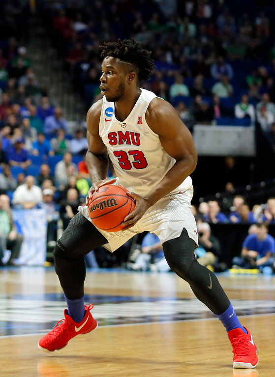 . SMU\'s Semi Ojeleye (33) handles the ball in the first half of a first-round game in the men\'s NCAA college basketball tournament against USC in Tulsa, Okla., Friday March 17, 2017. (AP Photo/Tony Gutierrez)