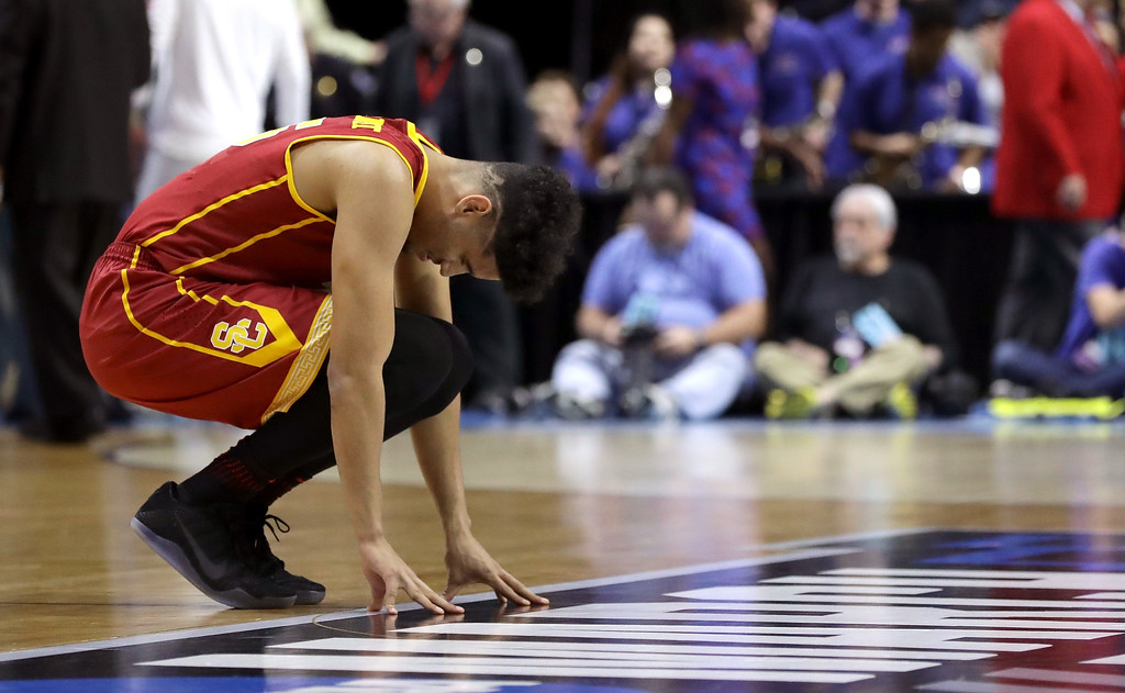 . TULSA, OK - MARCH 17: Bennie Boatwright #25 of the USC Trojans kneels at center court at the start of the game against the Southern Methodist Mustangs during the first round of the 2017 NCAA Men\'s Basketball Tournament at BOK Center on March 17, 2017 in Tulsa, Oklahoma.  (Photo by Ronald Martinez/Getty Images)