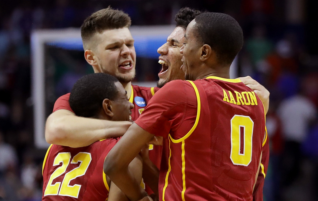 . TULSA, OK - MARCH 17: De\'Anthony Melton #22, Nick Rakocevic #31, Bennie Boatwright #25 and Shaqquan Aaron #0 of the USC Trojans celebrate after defeating the Southern Methodist Mustangs during the first round of the 2017 NCAA Men\'s Basketball Tournament at BOK Center on March 17, 2017 in Tulsa, Oklahoma.  (Photo by Ronald Martinez/Getty Images)
