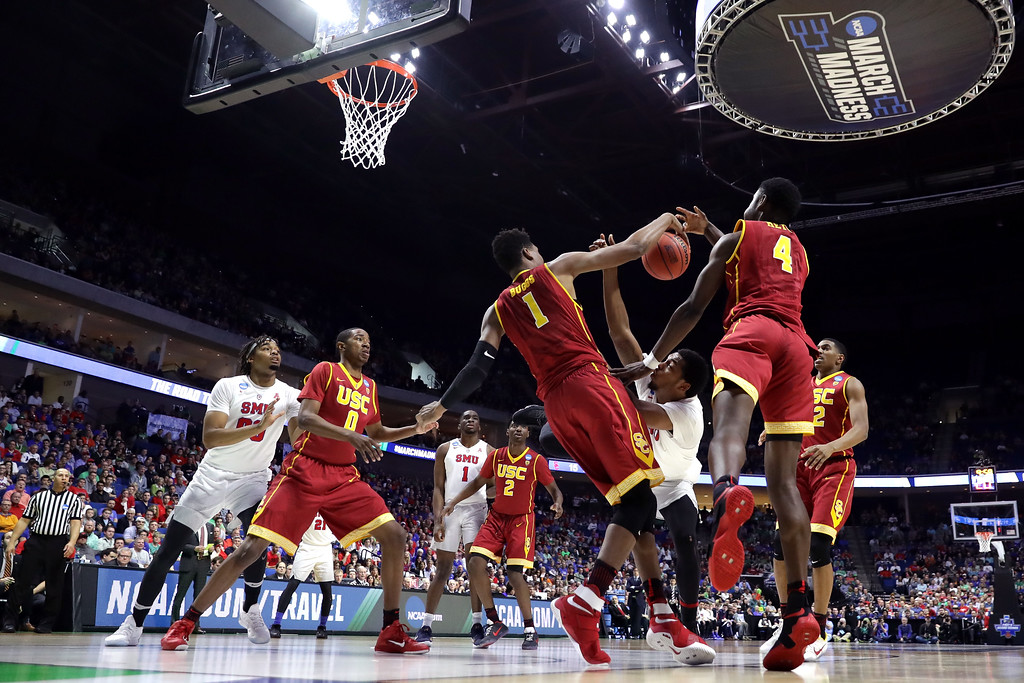 . TULSA, OK - MARCH 17:  Sterling Brown #3 of the Southern Methodist Mustangs competes for a loose ball against Chimezie Metu #4 and Charles Buggs #1 of the USC Trojans in the first half during the first round of the 2017 NCAA Men\'s Basketball Tournament at BOK Center on March 17, 2017 in Tulsa, Oklahoma.  (Photo by Ronald Martinez/Getty Images)