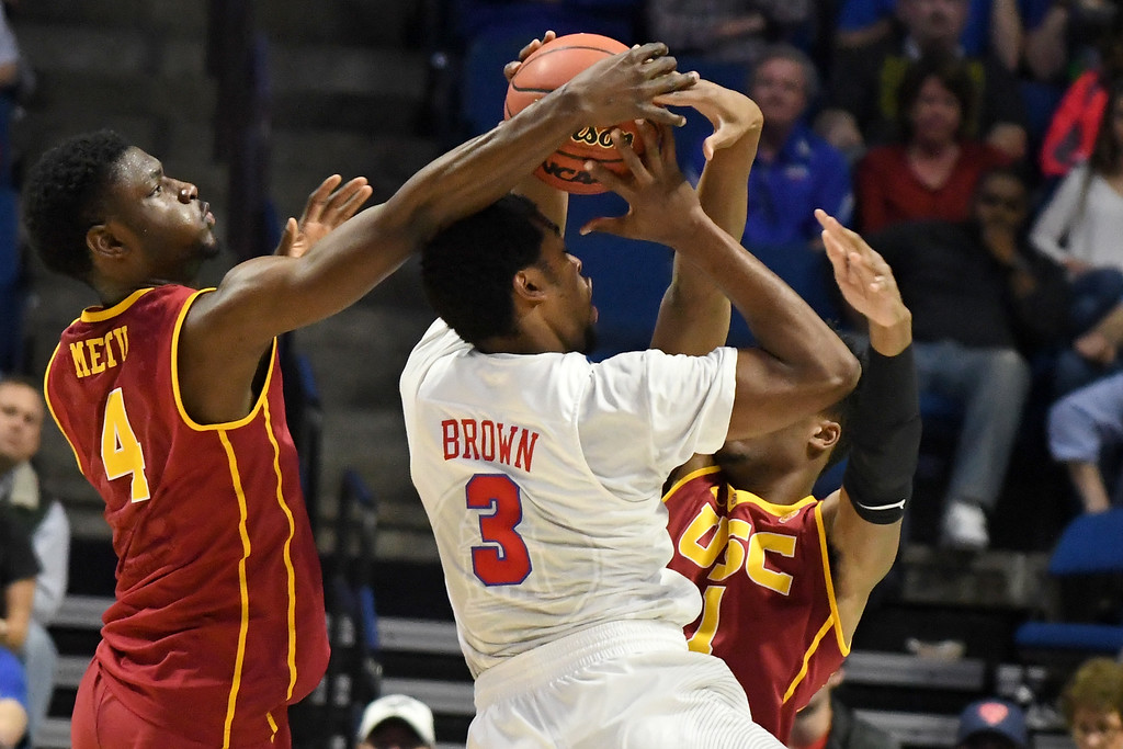 . TULSA, OK - MARCH 17: Sterling Brown #3 of the Southern Methodist Mustangs is defended by Chimezie Metu #4 and Charles Buggs #1 of the USC Trojans in the first half during the first round of the 2017 NCAA Men\'s Basketball Tournament at BOK Center on March 17, 2017 in Tulsa, Oklahoma.  (Photo by J Pat Carter/Getty Images)