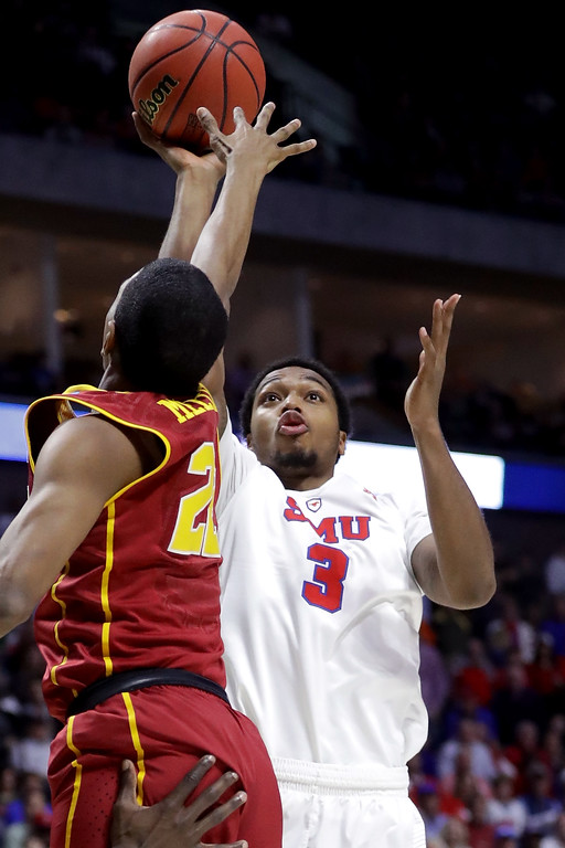 . TULSA, OK - MARCH 17: Sterling Brown #3 of the Southern Methodist Mustangs shoots against De\'Anthony Melton #22 of the USC Trojans in the first half during the first round of the 2017 NCAA Men\'s Basketball Tournament at BOK Center on March 17, 2017 in Tulsa, Oklahoma.  (Photo by Ronald Martinez/Getty Images)