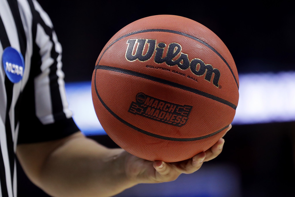 . TULSA, OK - MARCH 17: A referee holds a game ball in the second half between the USC Trojans and the Southern Methodist Mustangs during the first round of the 2017 NCAA Men\'s Basketball Tournament at BOK Center on March 17, 2017 in Tulsa, Oklahoma.  (Photo by Ronald Martinez/Getty Images)