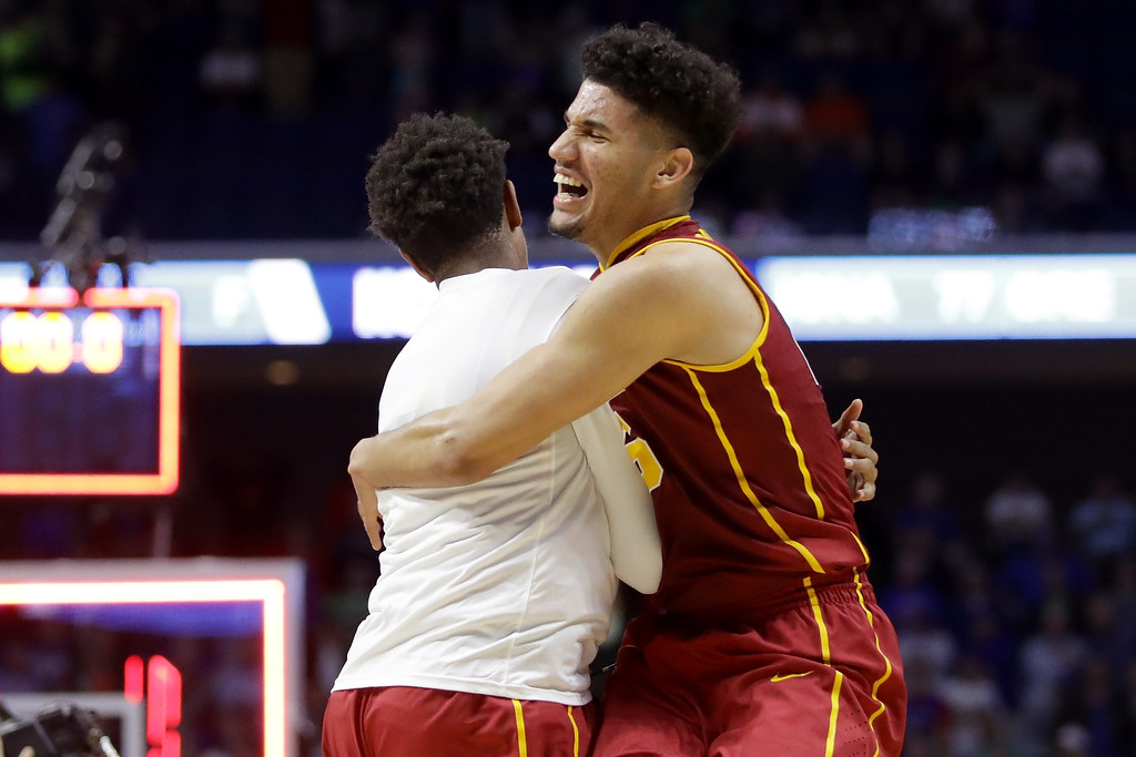 . TULSA, OK - MARCH 17: Bennie Boatwright #25 of the USC Trojans celebrates with a teammate after defeating the Southern Methodist Mustangs during the first round of the 2017 NCAA Men\'s Basketball Tournament at BOK Center on March 17, 2017 in Tulsa, Oklahoma.  (Photo by Ronald Martinez/Getty Images)