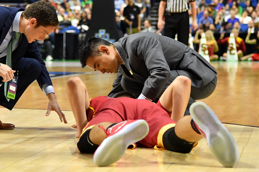 . TULSA, OK - MARCH 17: Nick Rakocevic #31 of the USC Trojans lies on the court after a fall in the first half against the Southern Methodist Mustangs during the first round of the 2017 NCAA Men\'s Basketball Tournament at BOK Center on March 17, 2017 in Tulsa, Oklahoma.  (Photo by J Pat Carter/Getty Images)