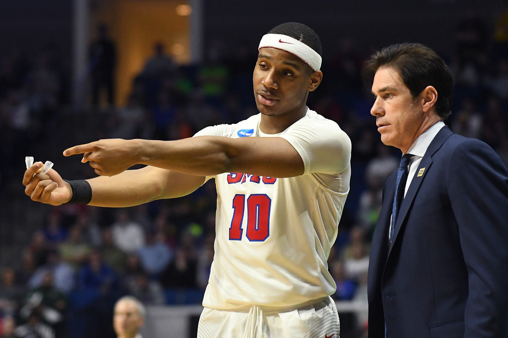 . TULSA, OK - MARCH 17:  Jarrey Foster #10 of the Southern Methodist Mustangs speaks to head coach Tim Jankovich in the second half against the USC Trojans during the first round of the 2017 NCAA Men\'s Basketball Tournament at BOK Center on March 17, 2017 in Tulsa, Oklahoma.  (Photo by J Pat Carter/Getty Images)