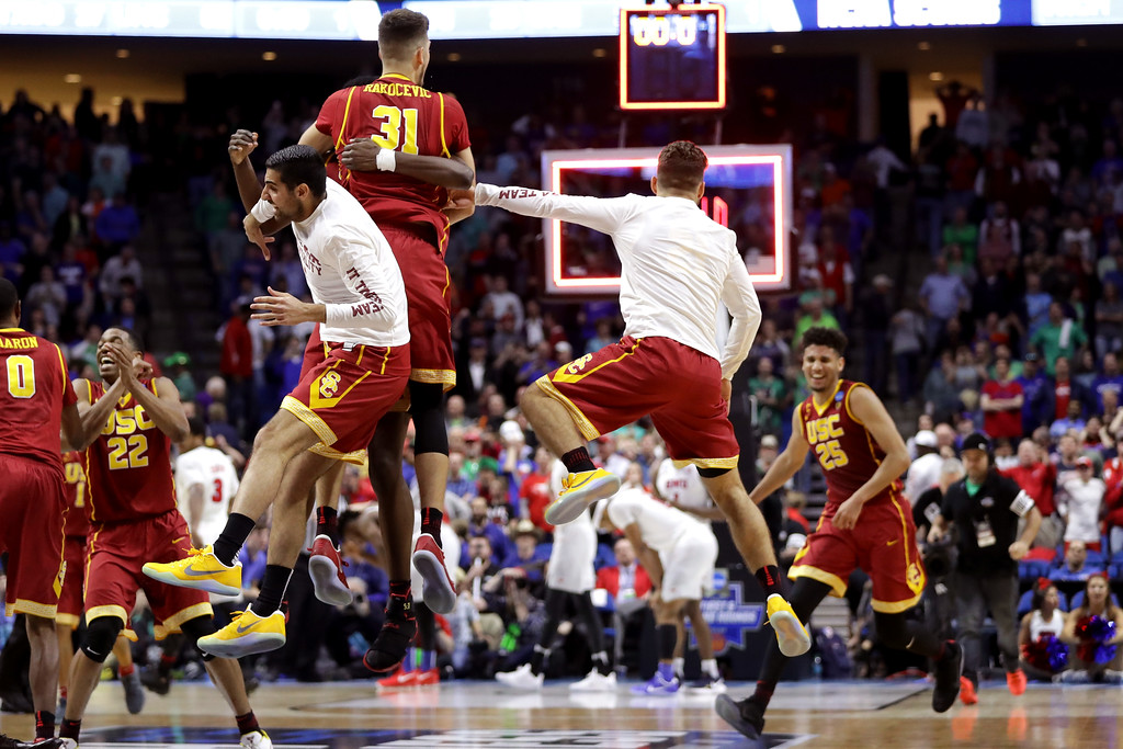 . TULSA, OK - MARCH 17:  The USC Trojans celebrate defeating the Southern Methodist Mustangs during the first round of the 2017 NCAA Men\'s Basketball Tournament at BOK Center on March 17, 2017 in Tulsa, Oklahoma.  (Photo by Ronald Martinez/Getty Images)