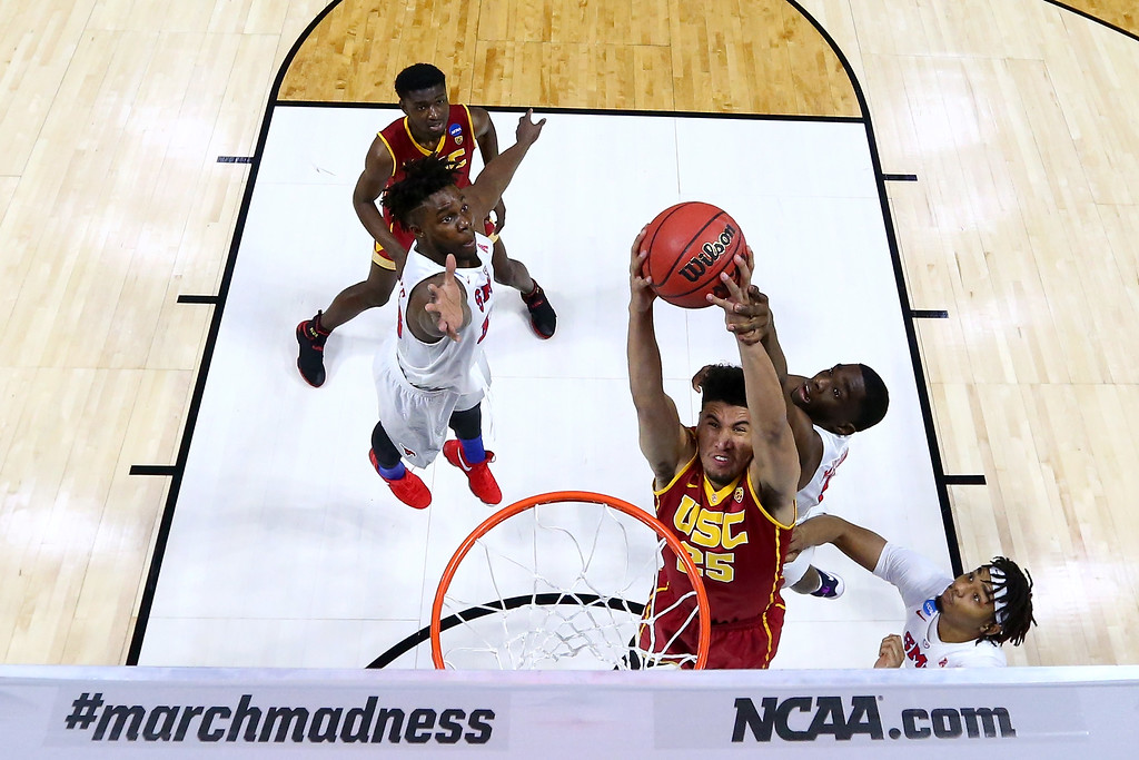 . TULSA, OK - MARCH 17: Bennie Boatwright #25 of the USC Trojans goes up with the ball against Shake Milton #1 of the Southern Methodist Mustangs in the first half during the first round of the 2017 NCAA Men\'s Basketball Tournament at BOK Center on March 17, 2017 in Tulsa, Oklahoma.  (Photo by Ronald Martinez/Getty Images)
