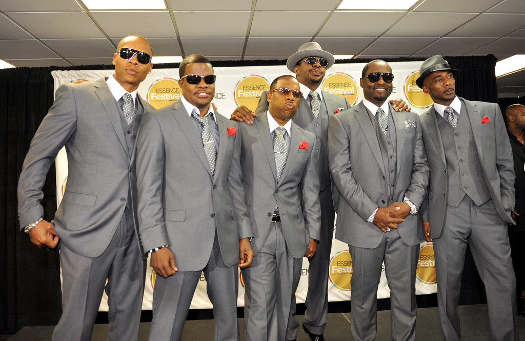 . From left, Ronnie DeVoe, Ricky Bell, Michael Bivens, Bobby Brown, Johnny Gill and Ralph Tresvant, of musical group New Edition, pose backstage at the Essence Festival at the Superdome on Saturday, July 6, 2013, in New Orleans. (Photo by Adrienne Battistella/Invision for Essence/AP Images)