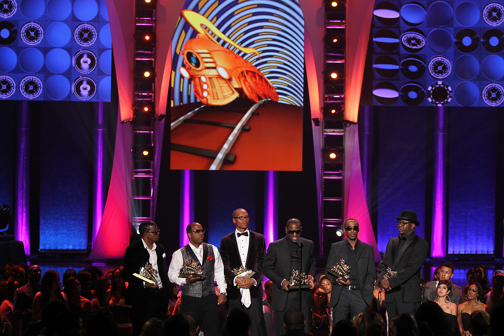 . LAS VEGAS, NV - NOVEMBER 08:  Singers Ricky Bell, Michael Bivens, Ronnie Devoe, Johnny Gill, Ralph Tresvant and Bobby Brown of New Edition accept the Soul Train Lifetime Achievement Award during the Soul Train Awards 2012 at PH Live at Planet Hollywood Resort & Casino on November 8, 2012 in Las Vegas, Nevada. .  (Photo by Isaac Brekken/Getty Images for Centric)