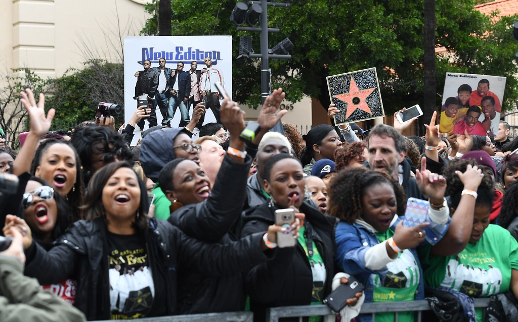 """. Fans cheer at the \""""New Edition\"""" star ceremony on the Hollywood Walk of Fame on January 23, 2017 in Hollywood, California. (ANGELA WEISS/AFP/Getty Images)"""