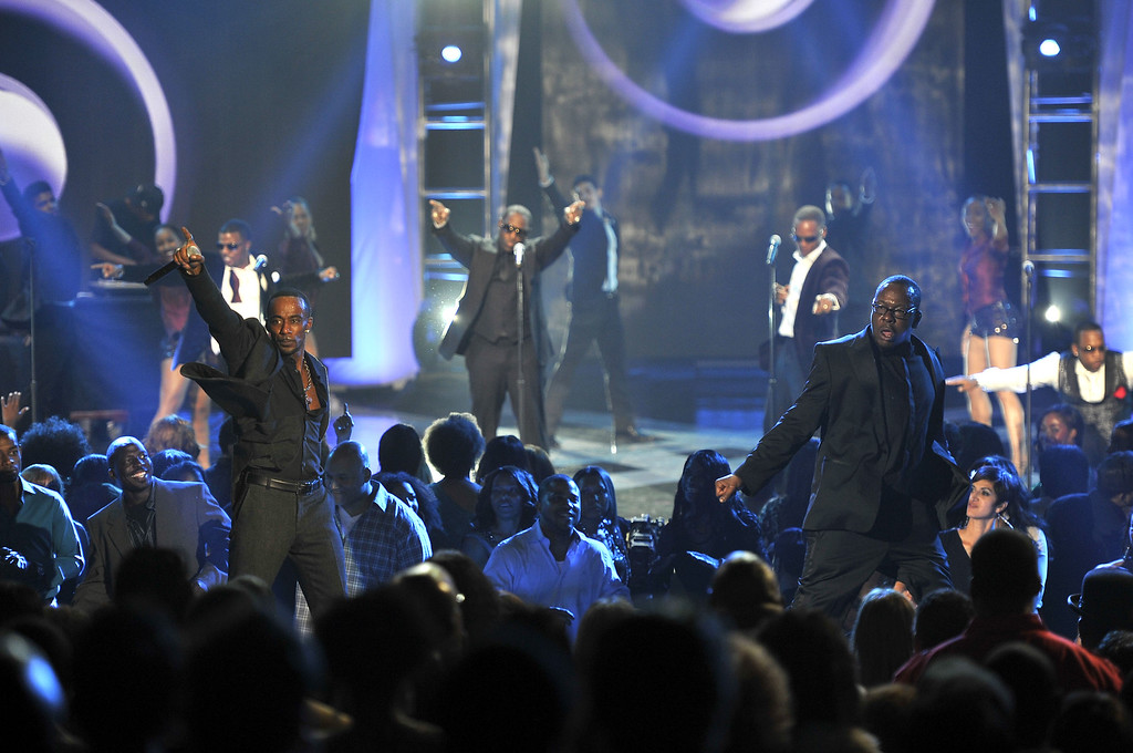 . This Thursday, Nov. 8, 2012 photo shows Ralph Tresvant, foreground left, and Bobby Brown, foreground right, of New Edition performing at the Soul Train Awards at Planet Hollywood Resort and Casino in Las Vegas. (Photo by Jeff Bottari/Invision/AP)