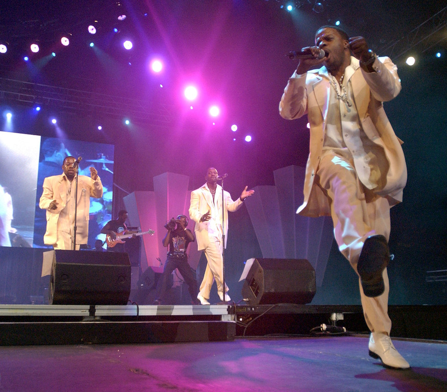 . New Edition singer Ricky Bell (foreground) performs at the 10th Anniversary Essence Music Festival at the Superdome on July 4, 2004 in New Orleans, Louisiana. (Photo by Chris Graythen/Getty Images)