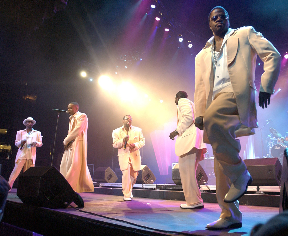 . NEW ORLEANS - JULY 4:  New Edition (L-R) Ralph Tresvant, Ronnie DeVoe, Michael Bivins, Johnny Gill, Ricky Bell performs at the 10th Anniversary Essence Music Festival at the Superdome on July 4, 2004 in New Orleans, Louisiana.  (Photo by Chris Graythen/Getty Images)