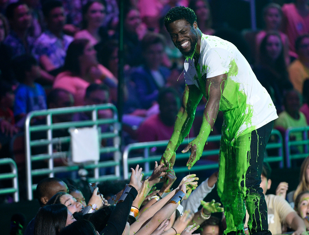 """. Kevin Hart after accepting the award for favorite villain for \""""The Secret Life of Pets\"""" and being slimed, greets fans in the audience at the Kids\' Choice Awards at the Galen Center on Saturday, March 11, 2017, in Los Angeles. (Photo by Chris Pizzello/Invision/AP)"""