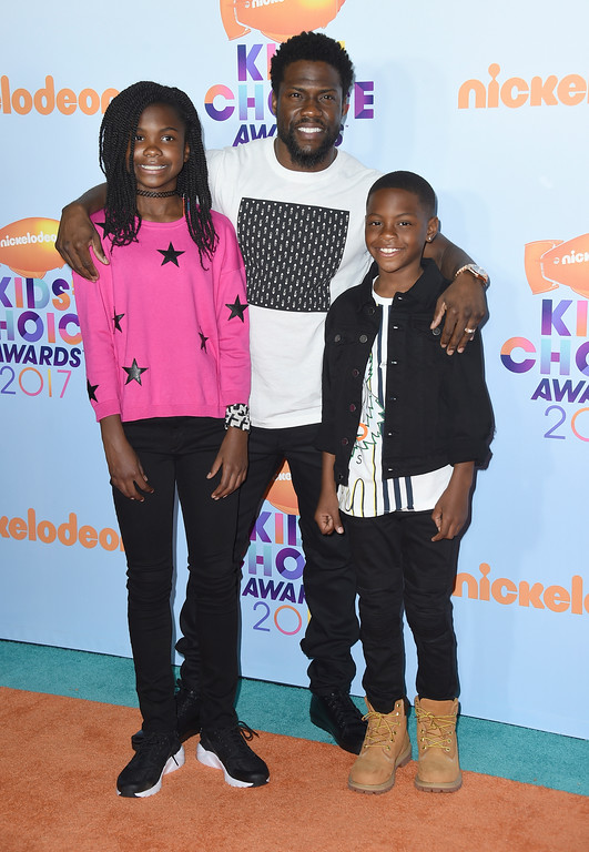 . Kevin Hart, center, and his children Heaven Hart, left, and Hendrix Hart arrive at the Kids\' Choice Awards at the Galen Center on Saturday, March 11, 2017, in Los Angeles. (Photo by Jordan Strauss/Invision/AP)