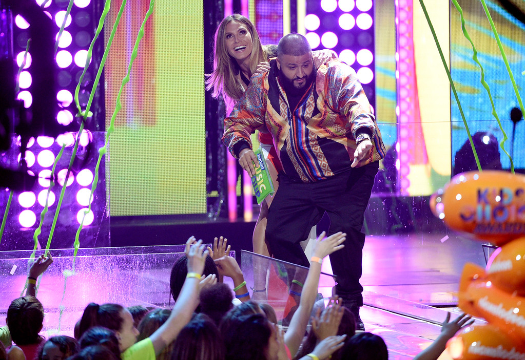 . DJ Khaled, right, and Heidi Klum present the award for favorite music group at the Kids\' Choice Awards at the Galen Center on Saturday, March 11, 2017, in Los Angeles. (Photo by Chris Pizzello/Invision/AP)