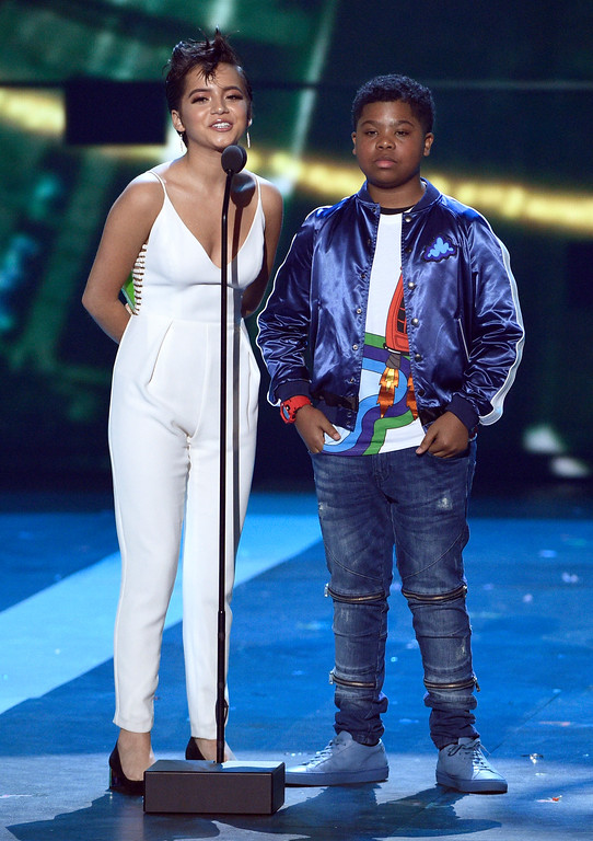 . Isabela Moner, left, and Benjamin Flores Jr. present the award for favorite family TV show at the Kids\' Choice Awards at the Galen Center on Saturday, March 11, 2017, in Los Angeles. (Photo by Chris Pizzello/Invision/AP)